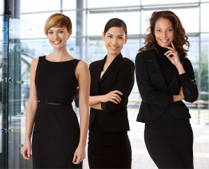 Three businesswomen standing in office building
