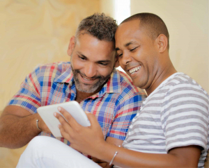 Male couple looking at tablet