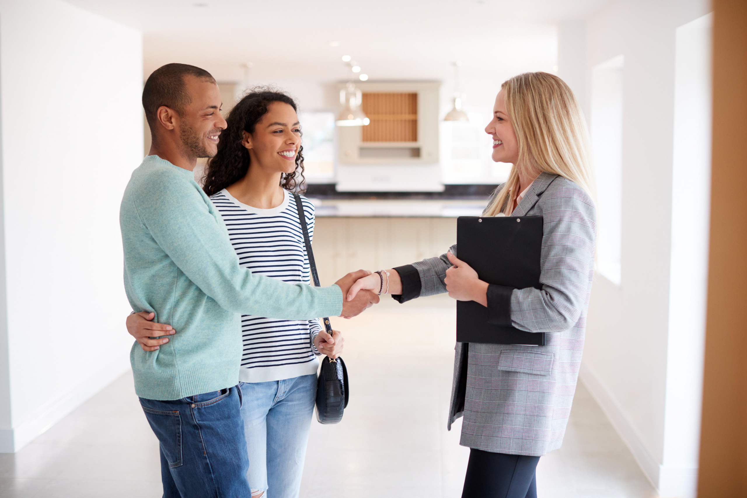 Couple meeting realtor in house